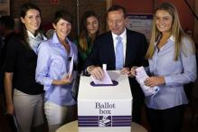 Conservative leader Tony Abbott expected to win Australian election as polls begin