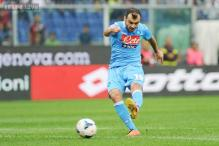 Napoli beat Genoa 2-0 to move top of Serie A