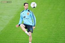 Atletico tie defender Juanfran Torres until 2017
