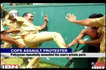 Kerala policemen brutally assault protestor waving black flag at CM