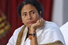 Mamata gives away cheques to defrauded Saradha depositors