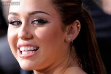 Miley Cyrus sticks her tongue out again