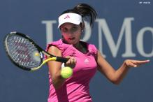 US Open 2013: Sania Mirza-Jie Zheng enter semi-finals