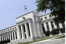 US Fed surprises, sticks to stimulus as it cuts growth outlook