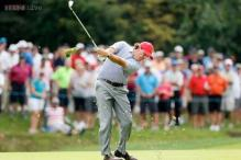 US stay in lead as rain interrupts Presidents Cup