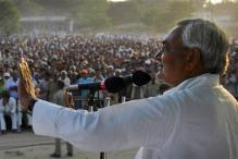 Nitish Kumar greets people at 'Ravana Vadh' function in Gandhi Maidan
