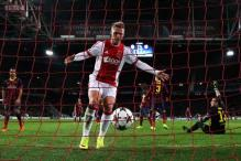 Ajax end Barcelona unbeaten run to stay in contention