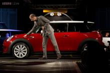 BMW unveils new Mini; may come to India next year