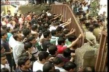Mumbai: Police try to break lock at Campa Cola society, detain protesters