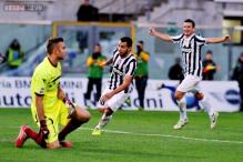 Juventus beat Livorno 2-0 to move top of Serie A