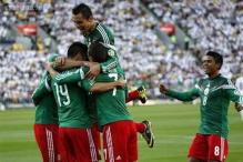 Peralta hat-trick guides Mexico to World Cup