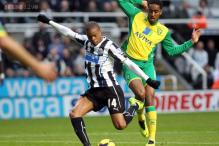 Newcastle beat Norwich 2-1 as Swansea down Fulham