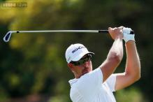 Dubai leader Stenson aims to hold off Poulter