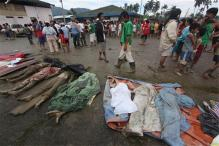 Typhoon struck Philippine begins mass burial