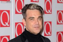Robbie William slams Liam Gallagher for infidelity