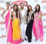 Models cover up for the Kingfisher Calendar launch party