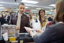 Barack Obama and daughters go big on books, halt traffic at local store