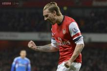 EPL leaders Arsenal beat Hull City 2-0