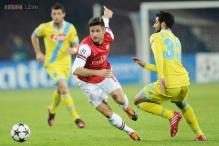 Arsenal advance despite 2-0 loss at Napoli in Champions League