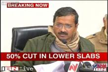 AAP keeps its poll promise, cuts power tariff by 50 per cent in Delhi