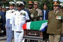 With a hole in its heart, South Africa buries Nelson Mandela