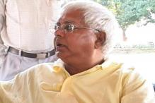 Police officers wash Lalu's feet, carry his slippers, probe ordered