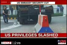 India acts tough against US, withdraws diplomatic privileges