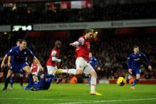 Arsenal beat Cardiff 2-0; Everton grab late draw at Stoke