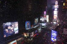 Ball drops in New York City's Times Square, ushering 2014