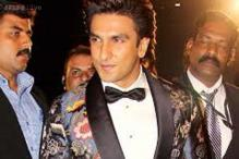 Bow-tie, embroidered jacket; Ranveer's unusual look at Filmfare Awards