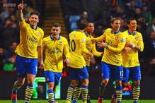 Arsenal survive late scare at Villa to go top