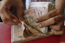 Rupee up 34 paise against dollar in early trade