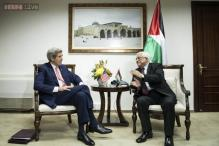 Palestinian protesters shout slogans in protest of John Kerry's visit