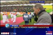 Sochi Olympic torch reaches Dagestan in Russia
