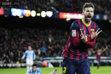 Barcelona ease past Malaga 3-0, reclaim top spot