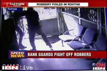 Caught on camera: Guards fight off armed robbers at SBI branch