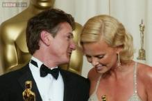 Sean Penn wants his relationship with Charlize Theron to work