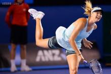 Sharapova overpowers Mattek-Sands to reach second round
