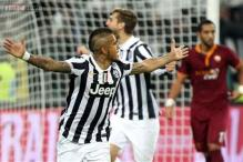 Juventus beat 9-man Roma to take 8-point lead