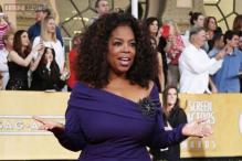 Larger than life Oprah Winfrey to celebrate 60th birthday quietly at home