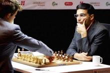 Viswanathan Anand draws with Magnus Carlsen, occupies joint fourth spot