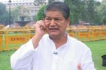 Dehradun: Uttarakhand CM hopeful Harish Rawat slaps party worker