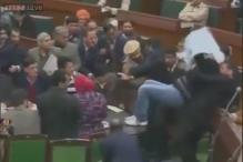 Unruly scenes in J&K Assembly, PDP members climb on table