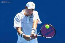 Isner holds off Sela to reach Delray quarters