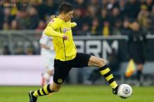 Lewandowski scores twice as Dortmund win 4-2 at Zenit in Champions League