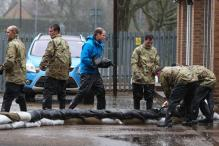 Princes William, Harry sandbag against UK floods