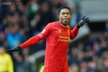 Liverpool beat Swansea 4-3; Remy scores winner for Newcastle