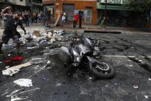 Venezuela death toll rises to 13 as protests flare