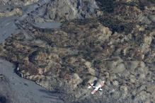 14 dead in Washington mudslide, search continues