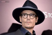 Johnny Depp looking to settle down with fiancé Amber Heard; thinking of an early retirement